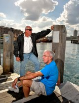Refusing to take the bait: Millers Point residents Bob Flood (standing) and Barney Gardner.