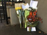 A floral tribute at the scene of the Brighton siege for Kai Hao.
