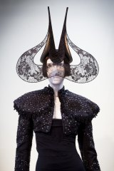 Lace Wings Hat by Philip Treacy, 2001, jacket by Alexander McQueen 2002, dress by Alexander McQueen, 2003 on display at the Isabella Blow: A Fashionable Life exhibition.