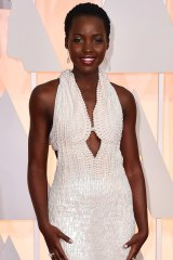 Lupita Nyong'o at the Oscars  at the Dolby Theatre in Los Angeles in the dress that was later stolen.