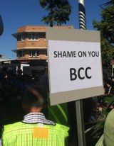 A woman at the protest makes her thoughts on the Brisbane City Council clear.