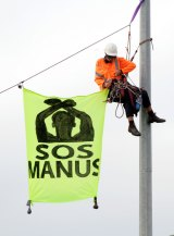 Refugee advocates blockade the entrance to Melbourne's container port on the Footscray Road to call for an end to the  regime on Manus and the detention of all refugees this month.