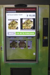 A vending machine that contains cannabis flower, hemp-oil energy drinks, and other merchandise at Seattle Caregivers, a medical marijuana dispensary, in Seattle.