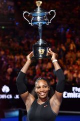 Serena Williams holds the trophy aloft last year.