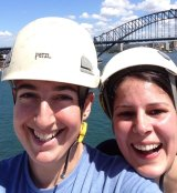Poppy Danis (left) and Lara Paignans were among four activists who climbed the Sydney Opera House and attempted to unfurl a banner to protest against the treatment of refugees on Manus Island.