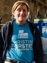 Liberal candidate Christine Forster hands out how-to-vote cards in Surry Hills.
