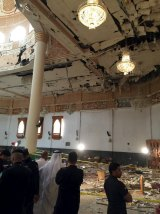 Police inspect the mosque after the explosion.