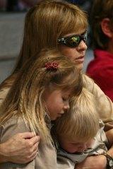 Terri Irwin with daughter Bindi and son Robert watching the Steve Irwin memorial service at Australia Zoo in 2006.