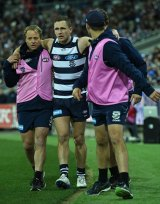Joel Selwood helped off the field after injuring himself on August 4.
