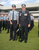Police Dog Bravo and his handler, Sergeant Constable Joseph Alofipo are welcomed by Queensland Police Service Commissioner Ian Stewart.