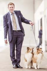 """""""Sometimes the outfit I wear is based on the judge. If the judge is a little bit out there, you can wear a brighter jacket, a more flamboyant tie."""" Darren Griffiths, of Melbourne, with Shetland sheepdogs."""