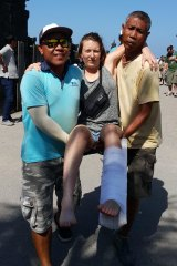 One woman who was a passenger on the ferry is carried by Wahana Bali's staff.