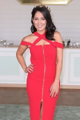 Mel McLaughlin poses at the Emirates Marquee in a Yeojin Bae dress.