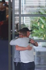 Heartbreaking: Australian cricketers Brad Haddin and Aaron Finch at St Vincent's Hospital in Sydney to see teammate Phillip Hughes.