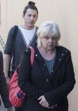 Aron Dennis and Roxene Dennis, mother of Kristen Schroder, leave Glebe Coronor's Court.