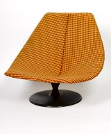 Gordon Andrews' Rondo chair had a fibreglass shell with spun aluminium base, and covered in Knoll wool fabric.