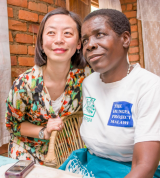 Ailan Tran with Elisabeth in Malawi.