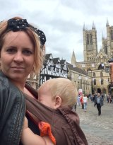 Holly Zwaif travelling in the UK with her child.