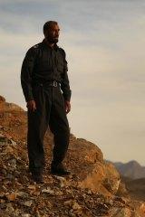 'I do things; they talk': Matiullah Khan on a mountain ridge in Oruzgan province in January 2013.