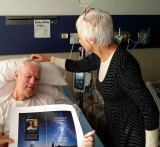 Brendan and Glendah in Beechworth Hospital with the cover of his book.