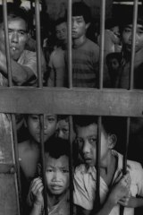 Laotian refugees who fled communist rule await processing in Nong Khai province, Thailand, in January 1978.