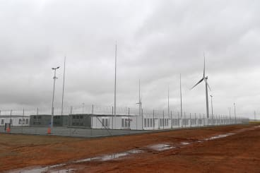 The batteries are co-located with Neoen's wind farm, storing energy generated by wind power.