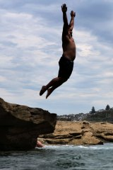 Bathers beat sweltering weather in Sydney's Eastern Suburbs by taking the plunge at Coogee Beach.