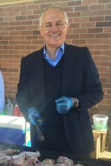 Malcolm Turnbull on the BBQ at Penrith South Public School.