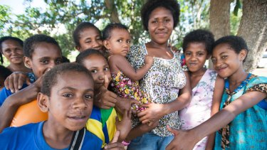 Mother Martina and daughter Angeline, centre, with other children at the Nine Mile settlement outside Port Moresby.