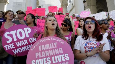Planned Parenthood supporters attend a rally in Los Angeles last year to campaign for access to reproductive health care.