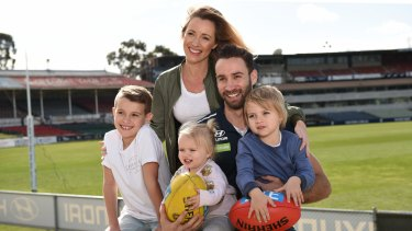 Retiring Blues veteran Andrew Walker with wife Kylie and children Cody, Arli and Leti.