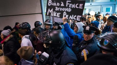 Protesters are surrounded by police at John F. Kennedy airport in New York.