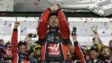 An emotional Kurt Busch celebrates victory.