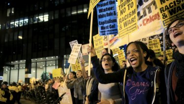 Protesters rally outside the Trump International Hotel and Tower.