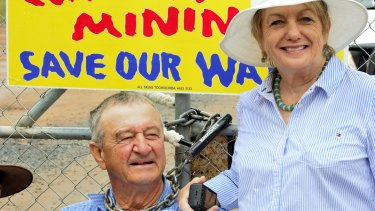 Sixth generation local farmer Neil Kennedy and his wife Anne at a protest at the Santos Leewood CSG waste water treatment plant on Wednesday.