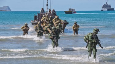 Australian and Singapore soldiers take part in an exercise at Shoalwater Bay.