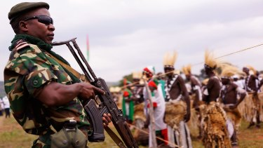Soldiers on guard as President Pierre Nkurunziza kicks off his official campaign for the presidency at a rally on Thursday  in Busoni, Burundi.
