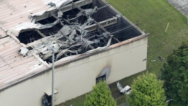 A warehouse which caught fire after an explosion is seen at the US Army Sagami General Depot in Sagamihara, southwest of Tokyo, Japan.