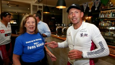 Former prime minister Tony Abbott meets with supporter and former resident of his electorate, Sharyn Aiken in Orange, during the 2016 Pollie Pedal tour on Thursday.