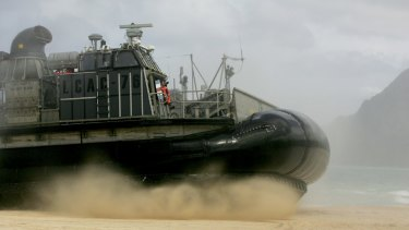 A US Navy landing craft air cushion amphibious vehicle storms the beach at Bellows Air Force Station on Oahu, Hawaii.