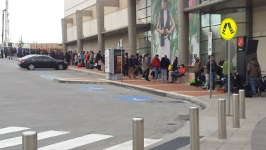 A line of more than 100 people outside Chadstone Shopping Centre in Victoria.