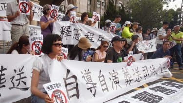 "People protest the Taiwanese Constitutional Court's decision in favour of marriage equality with signs reading  ""Same-sex marriage is unwelcome in Taiwan""."