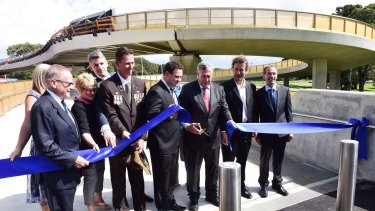 Roads Minister Duncan Gay cuts the ribbon at the bridge's opening.