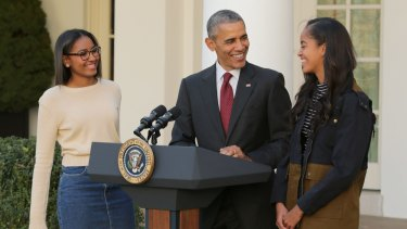 US President Barack Obama with daughters Sasha [left] and Malia.