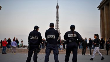 Police secure the centre of Paris the day after a gunman opened fire on officers.
