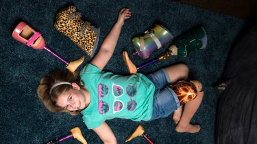 Leggy pride: Kayla Woods, 11, loves her decorated prosthetic limbs.