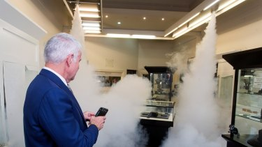Garry Holloway, owner of Holloway Diamonds in Brighton, demonstrating the new smoke security system.