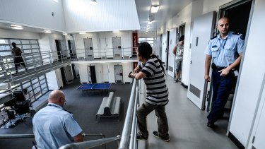 Warders and inmates at the  remand centre.