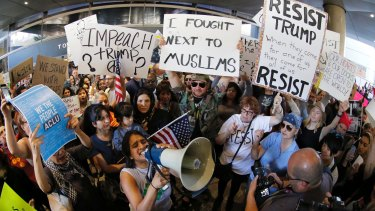 Demonstrators at Los Angeles International Airport in January protest President Trump's travel ban.