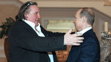 French actor Gerard Depardieu, left, greets Russian President Vladimir Putin in 2013.